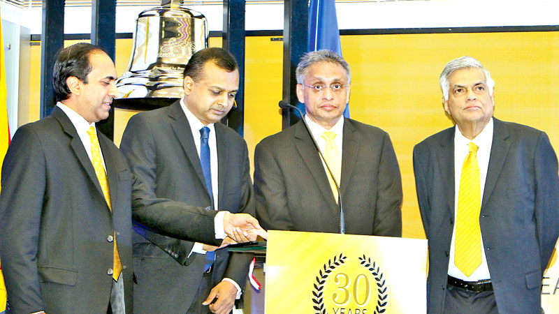 Prime Minister Ranil Wickremesinghe, CSE Chairman Vajira Kulatilaka, State Minister of National Policy and Economic Affairs, Niroshan Perera and Chief Executive Officer of CSE, Rajeeva Bandaranaike at the launch of the Global Industry Classification Standard (GICS) at the CSE. Picture by Saman Sri Wedage