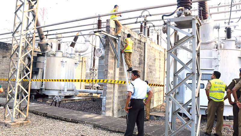 An explosion occurred at the Ceylon Electricity Board Kotugoda sub station resulting in a power interruption to several areas in Ja ela yesterday. CEB officials said that a fire erupted following the explosion and the Fire Brigade was called in to douse it.  CEB officials are seen inspecting the site.Picture by Saman Mendis