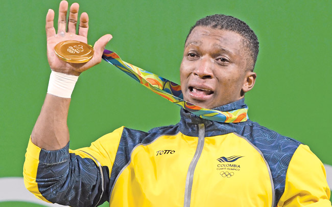 763032649237692416 together with Rio Olympics 2016 Games DAY THREE LIVE RESULTS TEAM GB GOLD MEDAL UPDATES Tom Daley Stars further 189526 furthermore 90027 additionally Photos Colombian Lifter Oscar Figueroa Retires After Lifting Gold. on oscar figueroa retires