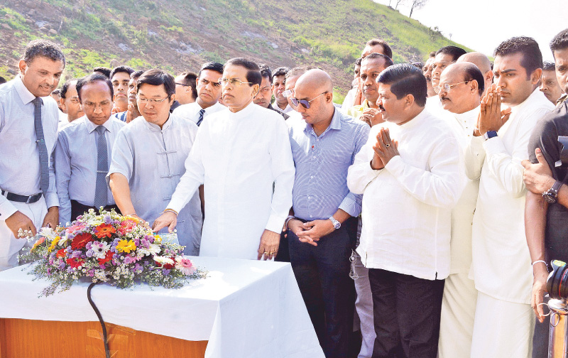President Maithripala Sirisena releasing the maiden waters of the Moragahakanda reservoir, built under Sri Lanka's largest multi-functional Irrigation Project. Chinese Ambassador Yi Xianliang, Ministers, politicians, public officials and a large gathering were present. Pictures by Sudath Malaweera