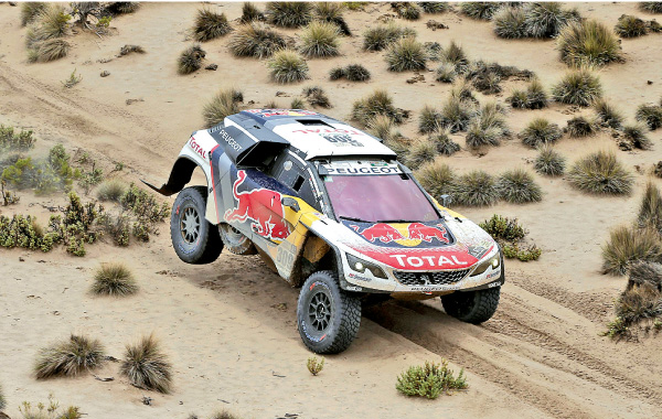 Driver Sebastien Loeb, of France, and co-driver Daniel Elena, of Monaco, race their Peugeot during the 7th stage of the Dakar Rally in Bolivia, on January 9. AFP