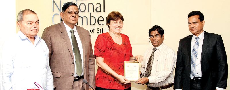 NCCSL immediate past President Thilak Godamanna is  handing over a token of appreciation to Cuban Ambassador to Sri Lanka  Juana Elena Rodrigues.NCCSL Deputy President Asela De Livera and the embassy's commercial counsellor Raul Grigorio look on. Picture by Sulochana Gamage.