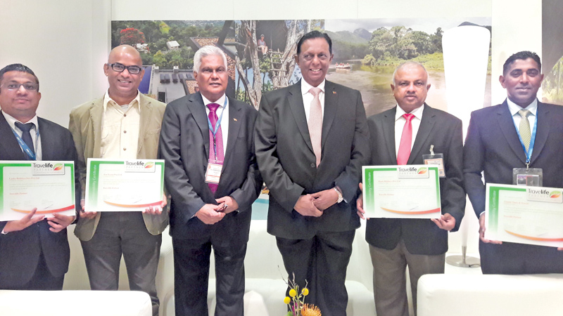 The award winners with Tourism Minister John Amaratunga and Chairman, Sri Lanka Tourism, Paddy Withana.