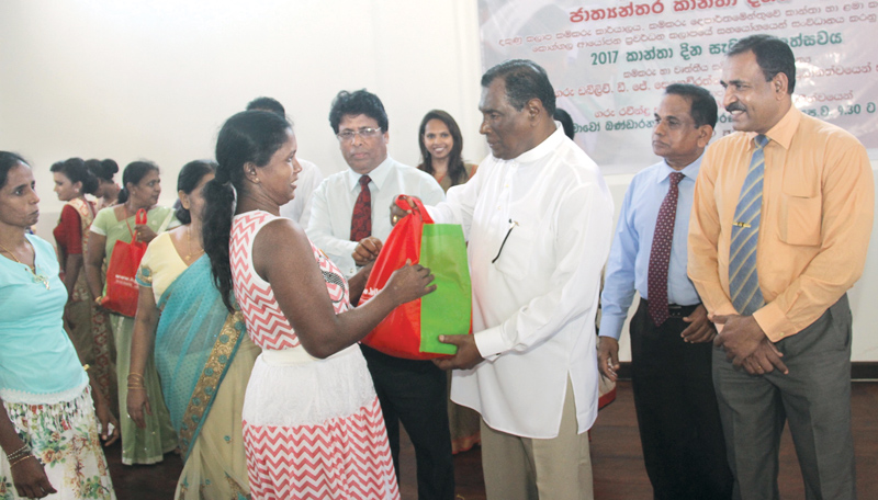 Ministers W. D. J. Seneviratne and Vajira Abeywardena at the International Women's Day celebration