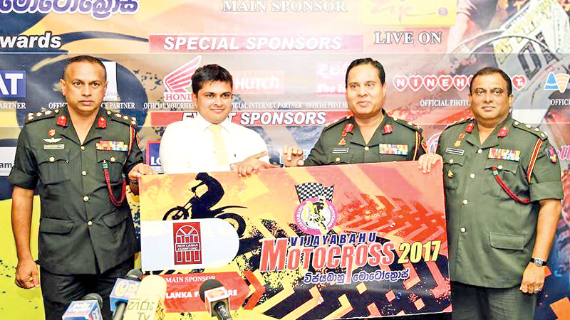 The Chief Executive Officer of New Lanka Furniture Lakmal Ranasiri (second from left) handing over the cheque for the Vijayabahu Motocross - 2017 to Security Forces Commander of Kilinochchi Major General Ajith Kariyakarawana.  Also in the picture are from left Brigadier Srinath Ariyasinghe and Chairman of Vijayabahu Motocross Organising Committee Brigadier Chandana Gunawardena. Picture by Ranjith Asanka