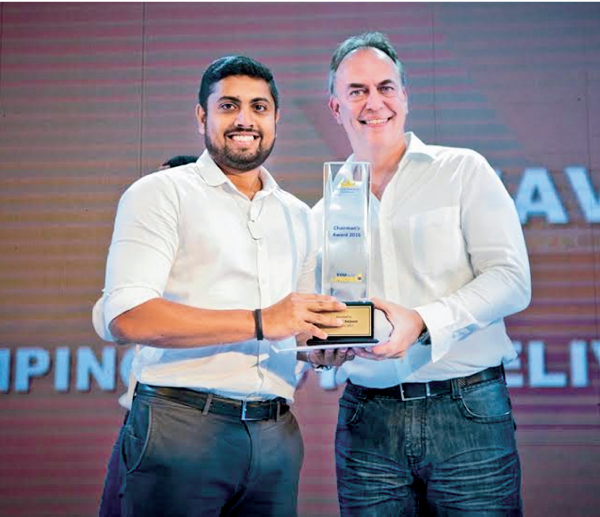 CTC Brands Planning and Insights Manager  Naveed Anjoon receiving the Chairman's Award from CEO Micheal Koest.