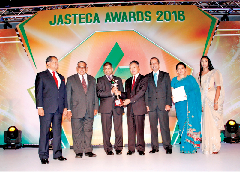 Sanjeewa Bandaranayake and PLC officials receiving the JASASTECA CSR and Sustainability Silver Award - 2016