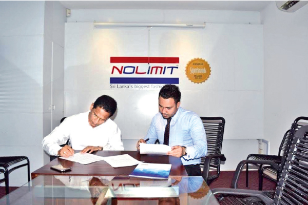 NOLIMIT's Marketing Manager Raneez Sheriff signing  the confirmation papers flanked by CH17 Loyalty CEO Jumar Preena.