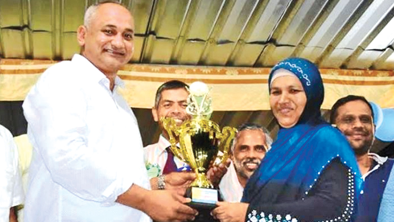 Habza House captain receiving the trophy from Eastern Province Health, Indigenous Medicine, Social Services, Probation Child Care and Rural Electrification Minister A.L.M.Nazeer. Picture by I.L.M.RIZAN, Addalaichenai, Central Correspondent
