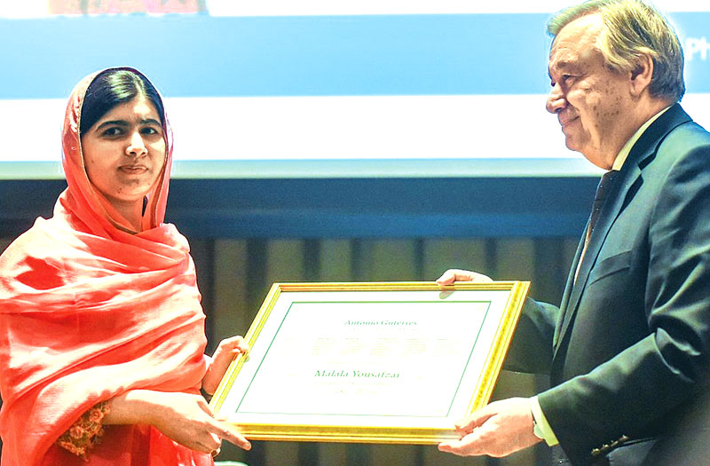 Malala Yousafzai attends a ceremony with United Nations Secretary General Antonio Guterres after being selected a United Nations messenger of peace in New York on Monday.