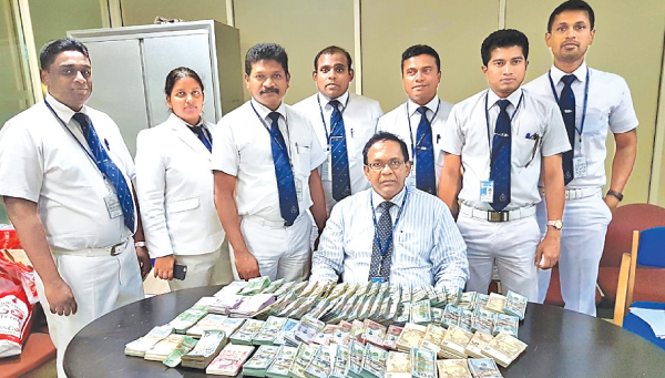 Customs nab two Indians with Rs.123 m worth foreign currency