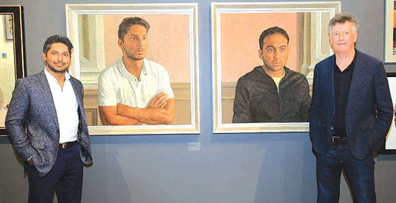 Kumar Sangakkara and artist Anthony Williams stand alongside the portraits of Sangakkara himself and Mahela Jayawardene.