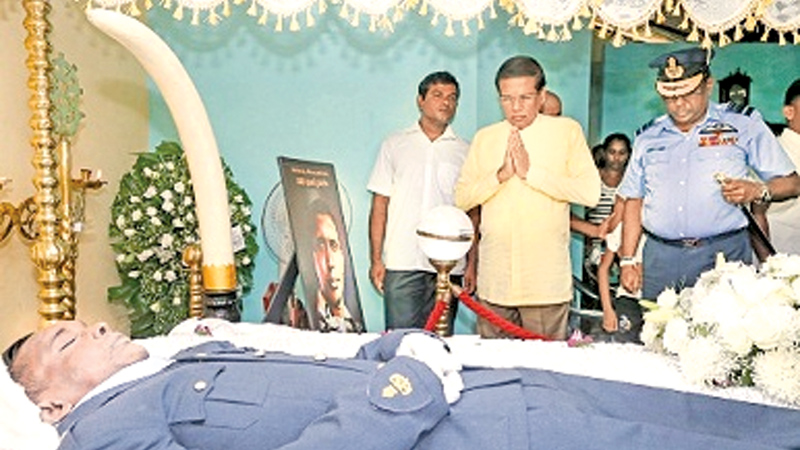 President pays last respects to SLAF officer....