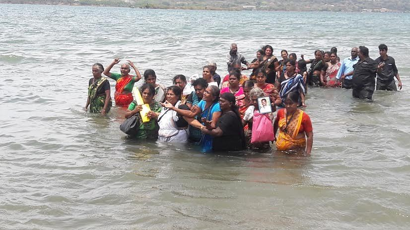 Families of disappeared walk into Trincomalee seas