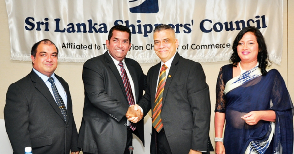 Sri Lanka Shippers' Council outgoing Chairman Sean Van Dort congratulates  newly appointed Council Chairman Chrisso de Mel at the AGM. Picture by Thushara Fernando