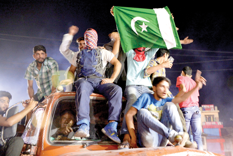Kashmiri cricket fans celebrate after Pakistan's win in the ICC Champions Trophy final cricket match against India on June 18 in downtown Srinagar. AFP