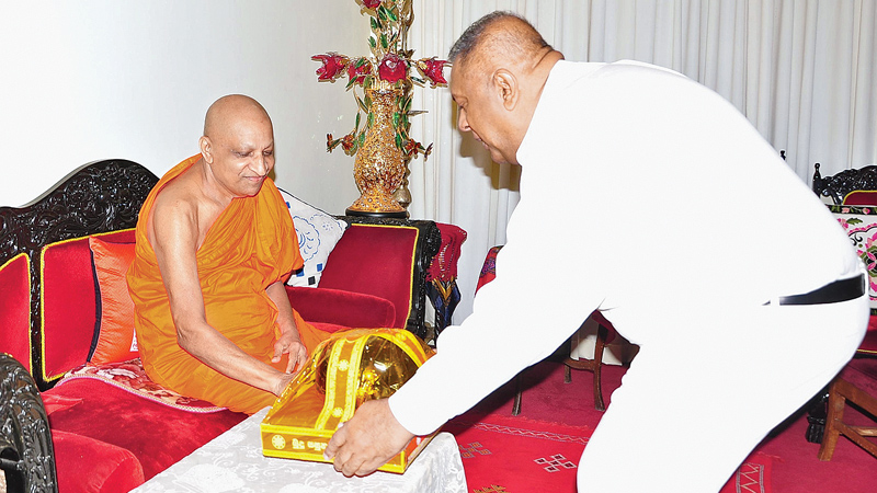 Finance and Mass Media Minister Mangala Samaraweera paying a courtesy call on Malwatte Mahanayake Thera Most. Ven. Thibbotuwawe Sri Siddhartha Sumangala Thera on Saturday. Picture by Gamini Ranasinghe