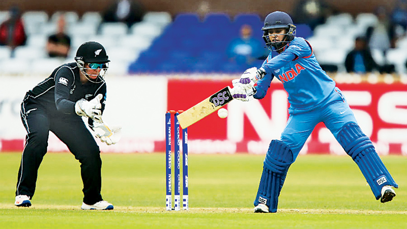 India's Mithali Raj gets runs on the off side during her century against New Zealand in the Women's World Cup match played at Derby on Saturday