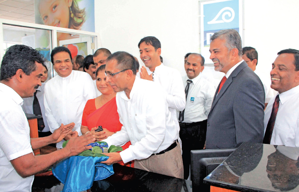 Minister Kabir Hasim accepting the first transaction