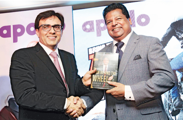 Rajesh Dahiya – Group Head Sales ISO ( India, SAARC, OCEANIA ) Apollo Tyres Ltd presenting a copy of 'The Man Behind the Wheel', the life story of Onka Singh Kanwar, founder of Apollo Tyres, to  Nalin Welgama - Chairman Ideal Wheels and Tyres