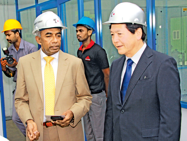 S. R. Gnanam, Managing Director of Tokyo Cement Company (Lanka) PLC with Tadashi Matsunami, Director and Senior Managing Executive Officer of Ube Industries Limited, Japan, at the factory inauguration in Trincomalee.