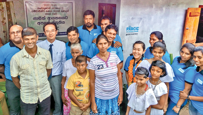 Japanese Embassy's Deputy Head of Missions Koji Yagi and PARCIC members with residents of Kotapola.