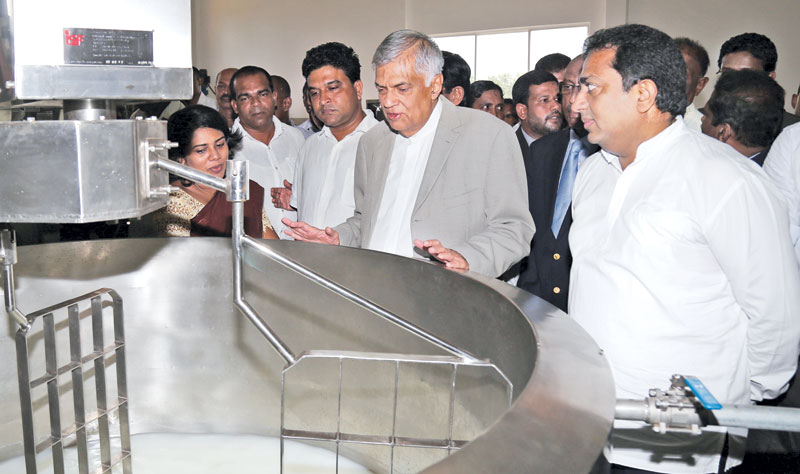 Prime Minister Ranil Wickremesinghe inspecting the newly constructed Business Research and Development Center in Kurunegala yesterday. Education Minister Akila Viraj Kariyawasam is also in the picture.