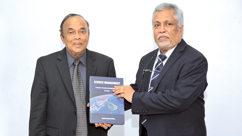 Prof.  Gamini Gunawardane and an invitee at the launch of his book