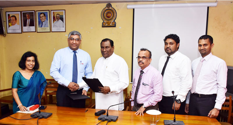Minister of Labour, Trade Union Relations and Sabaragamuwa  Development, D. J. Seneviratne and Nandana Ekanayake, CEO of INSEE  Cement (Left) shake hands after signing the agreement. Also in the  picture are Dr. Champika Amarasinghe, Director General of NIOSH (Left  corner), Nimal Sarantissa, Secretary of Ministry of Labour, Trade Union  Relations and Sabaragamuwa Development (3rd from Right), Gayan Fernando,  Head of Health & Safety of INSEE Cement (2nd from Right) and  Thushara Balasooriya, Talent Manager