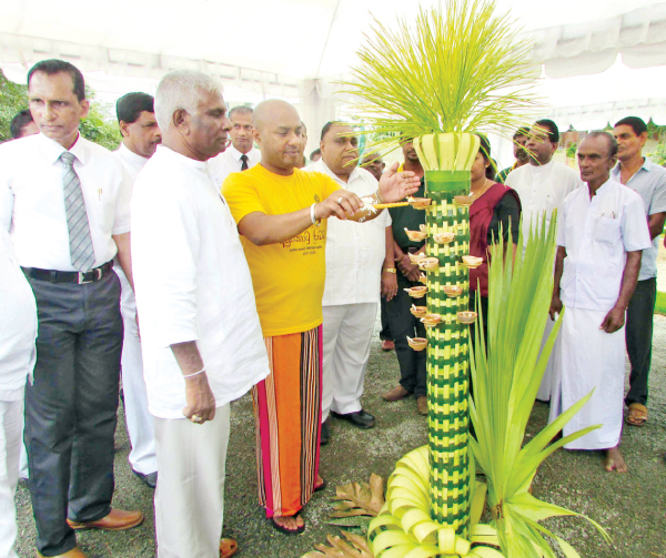 Agriculture Minister Duminda Dissanayake inaugurates Southern Province Vap Magula lighting the Oil Lamp.