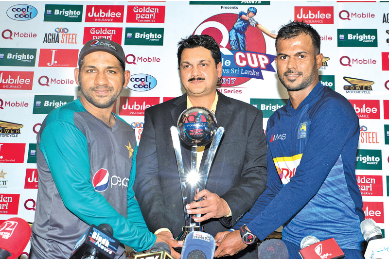 Rival captains Sarfraz Ahmed of Pakistan and Upul Tharanga of Sri Lanka with the trophy that will be awarded to the winners of the ODI series.
