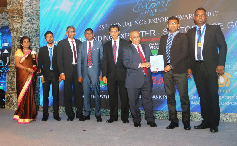 Nithyakalyani and N. J. Exports winning team with the awards.