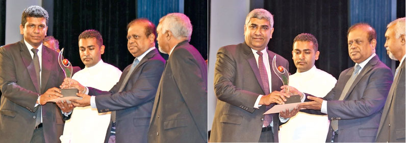 Siam City Cement (Lanka) CEO Nandana Ekanaya and General Manager of INSEE Ecocycle Sanjeewa Chulakumara receiving the award from Science, Technology and Research Minister A. D. Susil Premajayantha.