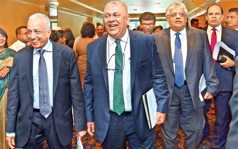 Finance and Media Minister Mangala Samaraweera, International Trade and Development Strategies Minister Malik Samarawickrema and Mano Tittawella, Senior Advisor to the Finance and Media Minister Mangala Samaraweera arriving for the Budget Forum organised by Ernst and Young at the Hilton, Colombo yesterday. Picture by Shan Rupassara