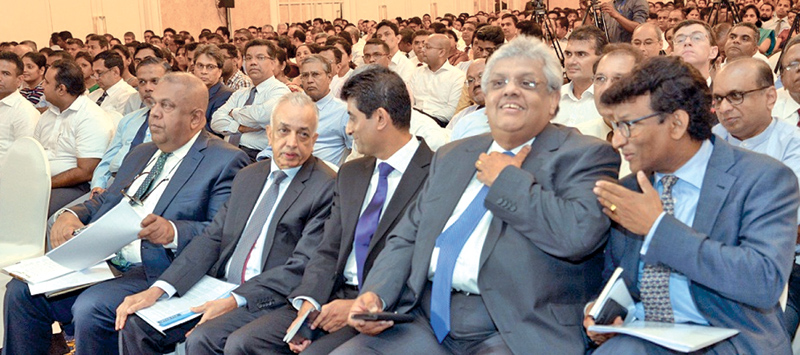 Finance and Mass Media Ministry Senior Advisor, Mano Tittawella and Finance Ministry's Public Private Partnership (PPP) Unit Chairman Thilan Wijesinghe at the forum. Picture by Shan Rupassara.