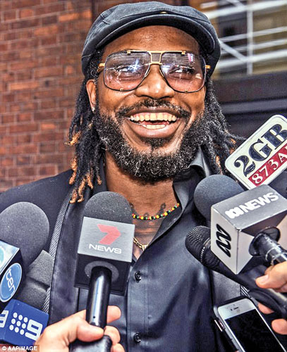 Chris Gayle speaks to the media after winning his defamation case against Fairfax Media. The cricketer has opened bidding for his tell-all story at $400,000.