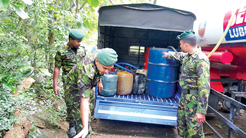 Mixing kerosene oil into petrol in secret operation.