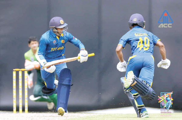 Ashen Bandara (back to the camera) who top scored for Sri Lanka with 49 goes for a run during their Under 19 Asia Cup Youth match against Pakistan on Monday.