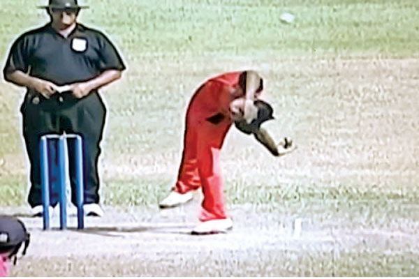 Kevin Koththigoda bowling with his unusual action.