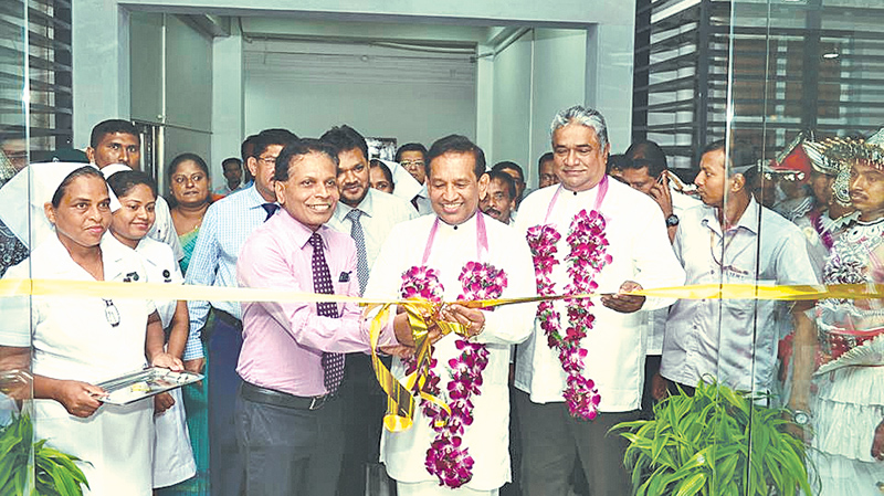 Health, Nutrition and Indigenous Medicine Minister Dr. Rajitha Senaratne opens the New Admin building of the National Eye Hospital while Health, Nutrition and Indigenous Medicine Deputy Minister Faizal Cassim and the Hospital Director Dr. Lionel Muhandiramge look on.