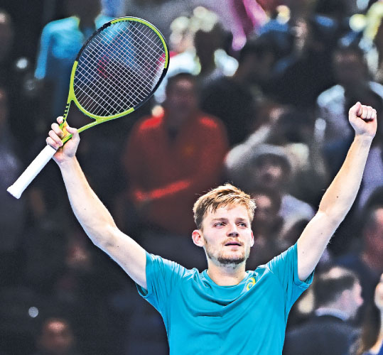 Belgium's David Goffin reacts after winning his singles match against Spain's Rafael Nadal on day two of the ATP World Tour Finals on November 13. AFP