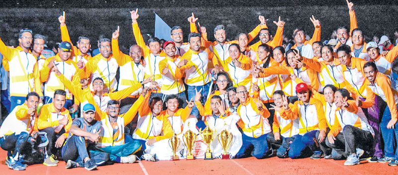 The jubilant Sampath Bank Athletics team with their trophies
