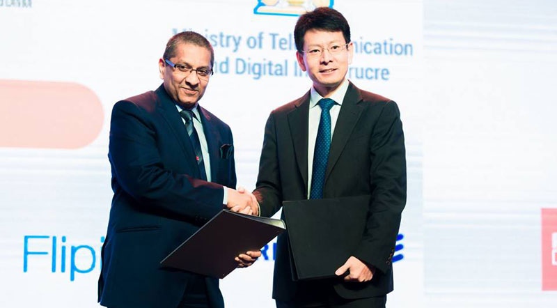 Jit Warnakulasuriya Chairman of JIT Group and Shunli Wang CEO of Huawei