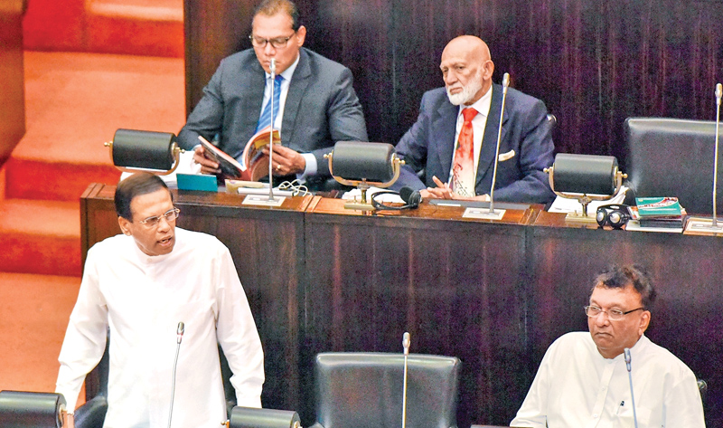 President Miaithripala Sirisena speaking in Parliament during the Committee Stage debate on the financial heads of the Health, Nutrition and Indigenous Medicine Ministry and Housing and Construction Ministry yesterday.  Picture by Sandaruwan Amarasinghe- President's Media Division.