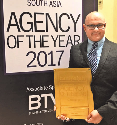 "Santosh Menon, Managing Director of BBDO Lanka, with the Gold award for ""Rest of South Asia Creative Agency of the Year"""