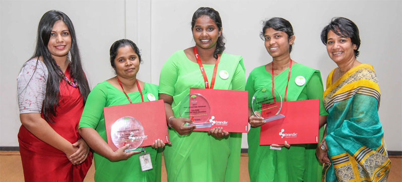 (Above) The winners of the Outstanding Award for Exceptional Performance with Anusha Alles, Head of CSR & Corporate Communications at Brandix (extreme right) and Sakura Manthreerathne, P.A.C.E. Specialist at Brandix and (Below) a section of the audience at one of the graduation ceremonies