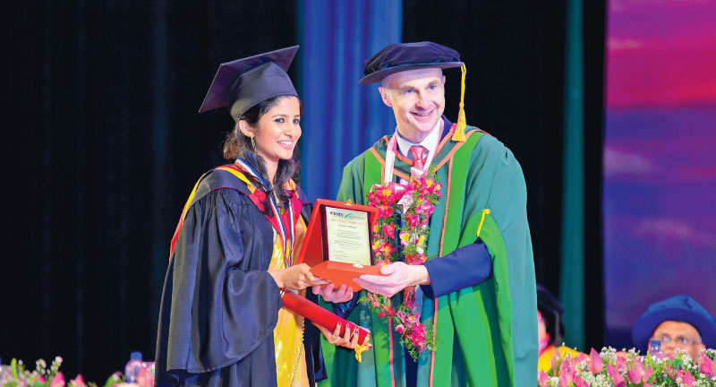 Shayani Ransika Vithanage receiving the  Dean's Best Student Award from Professor Jon Reast.