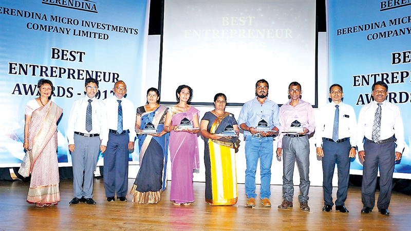 The winners with their awards.