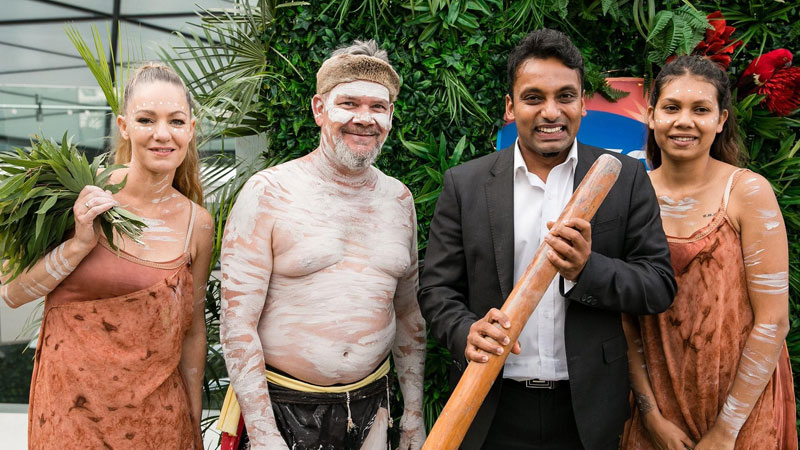 Yohan Ramasundara, holding a traditional indigenous didgeridoo, is the new ACS President