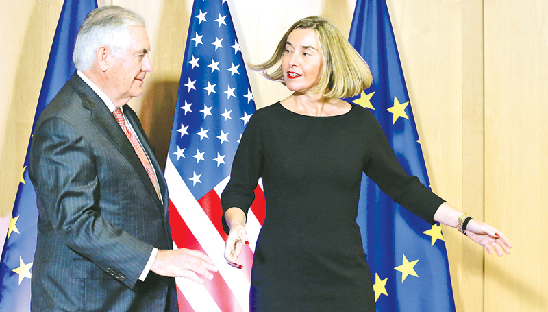 US Secretary of State Rex Tillerson is welcomed by European Union Foreign Policy  Chief Federica Mogherini in Brussels.